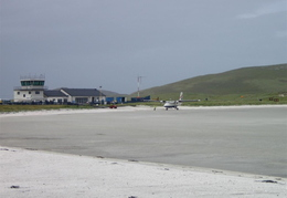 Aircraft in front of terminal