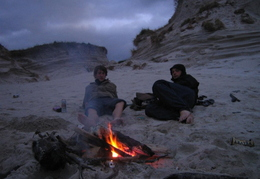 Talking sh1te around the fire. Camped on beach that night